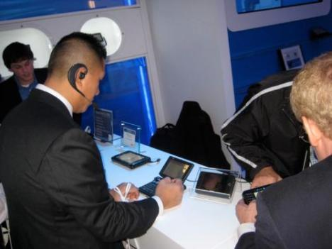 Business users try out mobile Internet devices at the Intel booth at CES 2008 in Las Vegas.